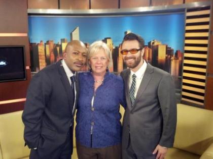 Good Day host Antwan Lewis poses with Goodwill's New Initiatives & Business Partnerships director, Martha Jackson and Call Forward graduate Andrew Ellzey after the street talk segment.
