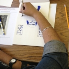Derek (Bronx Day Habilitation program) is inspired by ancient warriors. He's designing his own warrior symbols; utilizing the New York Public Library's digital image collection as a reference. This art piece is the first in a series of 9 warriors.