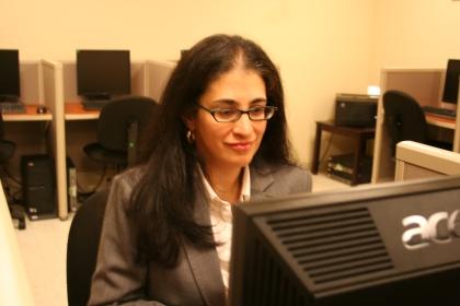 Lourdes at computer