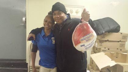 People holding turkeys