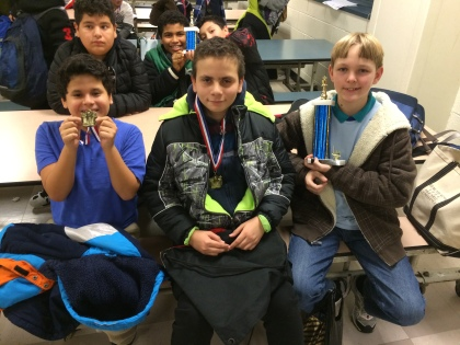 Danylo with team and medals